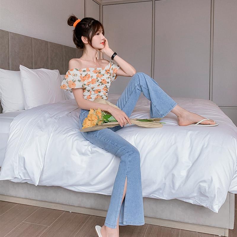 實拍2021秋季新款女簡約大氣開叉設計喇叭褲時尚冰氧吧拖地牛仔褲
